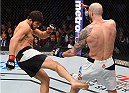 BOSTON, MA - JANUARY 17:  (L-R) Patrick Cote of Canada kicks Ben Saunders in their welterweight bout during the UFC Fight Night event inside TD Garden on January 17, 2016 in Boston, Massachusetts. (Photo by Jeff Bottari/Zuffa LLC/Zuffa LLC via Getty Images)