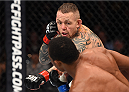 BOSTON, MA - JANUARY 17:  (R-L) Ross Pearson of England punches Francisco Trinaldo of Brazil in their lightweight bout during the UFC Fight Night event inside TD Garden on January 17, 2016 in Boston, Massachusetts. (Photo by Jeff Bottari/Zuffa LLC/Zuffa LLC via Getty Images)