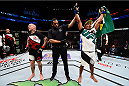BOSTON, MA - JANUARY 17:  Francisco Trinaldo (R) of Brazil celebrates after his victory over Ross Pearson of England in their lightweight bout during the UFC Fight Night event inside TD Garden on January 17, 2016 in Boston, Massachusetts. (Photo by Jeff Bottari/Zuffa LLC/Zuffa LLC via Getty Images)