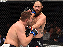 BOSTON, MA - JANUARY 17:  (L-R) Matt Mitrione punches Travis Browne in their heavyweight bout during the UFC Fight Night event inside TD Garden on January 17, 2016 in Boston, Massachusetts. (Photo by Jeff Bottari/Zuffa LLC/Zuffa LLC via Getty Images)