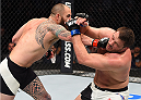 BOSTON, MA - JANUARY 17:  (L-R) Travis Browne punches Matt Mitrione in their heavyweight bout during the UFC Fight Night event inside TD Garden on January 17, 2016 in Boston, Massachusetts. (Photo by Jeff Bottari/Zuffa LLC/Zuffa LLC via Getty Images)