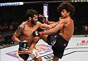 NEWARK, NJ - JANUARY 30:  (L-R) Masio Fullen punches Alex Caceres in their featherweight bout during the UFC Fight Night event at the Prudential Center on January 30, 2016 in Newark, New Jersey. (Photo by Josh Hedges/Zuffa LLC/Zuffa LLC via Getty Images)