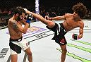 NEWARK, NJ - JANUARY 30:  (R-L) Alex Caceres kicks Masio Fullen in their featherweight bout during the UFC Fight Night event at the Prudential Center on January 30, 2016 in Newark, New Jersey. (Photo by Josh Hedges/Zuffa LLC/Zuffa LLC via Getty Images)