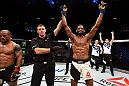BRISBANE, AUSTRALIA - MARCH 20:  (R-L) Neil Magny of the United States celebrates after defeating Hector Lombard of Cuba by TKO in their welterweight bout during the UFC Fight Night event at the Brisbane Entertainment Centre on March 20, 2016 in Brisbane, Australia. (Photo by Josh Hedges/Zuffa LLC/Zuffa LLC via Getty Images)