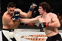 OTTAWA, ON - JUNE 18:   (R-L) Olivier Aubin-Mercier of Canada punches Thibault Gouti of France in their lightweight bout during the UFC Fight Night event inside the TD Place Arena on June 18, 2016 in Ottawa, Ontario, Canada. (Photo by Jeff Bottari/Zuffa LLC/Zuffa LLC via Getty Images)