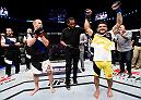 SIOUX FALLS, SD - JULY 13:   (R-L) John Lineker celebrates his knockout victory over Michael McDonald in their bantamweight bout during the UFC Fight Night event on July 13, 2016 at Denny Sanford Premier Center in Sioux Falls, South Dakota. (Photo by Jeff Bottari/Zuffa LLC/Zuffa LLC via Getty Images)