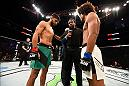 SALT LAKE CITY, UT - AUGUST 06:  (L-R) Yair Rodriguez of Mexico and Alex Caceres face off before the start of their featherweight bout during the UFC Fight Night event at Vivint Smart Home Arena on August 6, 2016 in Salt Lake City, Utah. (Photo by Jeff Bottari/Zuffa LLC/Zuffa LLC via Getty Images)