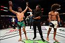 SALT LAKE CITY, UT - AUGUST 06:  (L-R) Yair Rodriguez of Mexico celebrates his victory over Alex Caceres after their featherweight bout during the UFC Fight Night event at Vivint Smart Home Arena on August 6, 2016 in Salt Lake City, Utah. (Photo by Jeff Bottari/Zuffa LLC/Zuffa LLC via Getty Images)