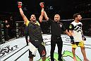 MANCHESTER, ENGLAND - OCTOBER 08:  (L-R) Leonardo Santos of Brazil celebrates his victory over Adriano Martins of Brazil in their lightweight bout during the UFC 204 Fight Night at the Manchester Evening News Arena on October 8, 2016 in Manchester, England. (Photo by Josh Hedges/Zuffa LLC/Zuffa LLC via Getty Images)