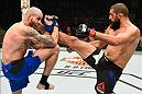PHOENIX, AZ - JANUARY 15:  (R-L) Court McGee kicks Ben Saunders in their welterweight bout during the UFC Fight Night event inside Talking Stick Resort Arena on January 15, 2017 in Phoenix, Arizona. (Photo by Jeff Bottari/Zuffa LLC/Zuffa LLC via Getty Images)