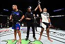 HOUSTON, TX - FEBRUARY 04:  (R-L) Marcel Fortuna of Brazil celebrates his knockout victory over Anthony Hamilton in their heavyweight bout during the UFC Fight Night event at the Toyota Center on February 4, 2017 in Houston, Texas. (Photo by Jeff Bottari/Zuffa LLC/Zuffa LLC via Getty Images)