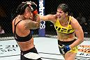 KANSAS CITY, MO - APRIL 15:  (R-L) Ketlen Vieira of Brazil punches Ashlee Evans-Smith in their women's bantamweight fight during the UFC Fight Night event at Sprint Center on April 15, 2017 in Kansas City, Missouri. (Photo by Josh Hedges/Zuffa LLC/Zuffa LLC via Getty Images)