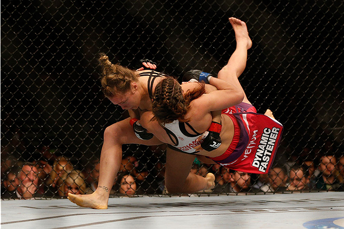 LAS VEGAS, NV - DECEMBER 28:  (L-R) Ronda Rousey throws Miesha Tate in their UFC women's bantamweight championship bout during the UFC 168 event at the MGM Grand Garden Arena on December 28, 2013 in Las Vegas, Nevada. (Photo by Josh Hedges/Zuffa LLC/Zuffa LLC via Getty Images) *** Local Caption *** Ronda Rousey; Miesha Tate