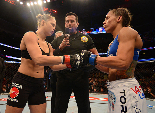 ANAHEIM, CA - FEBRUARY 23:  Ronda Rousey (left) and Liz Carmouche (right) touch gloves in their women's bantamweight title fight during UFC 157 at Honda Center on February 23, 2013 in Anaheim, California.  (Photo by Donald Miralle/Zuffa LLC/Zuffa LLC via Getty Images) *** Local Caption *** Ronda Rousey; Liz Carmouche