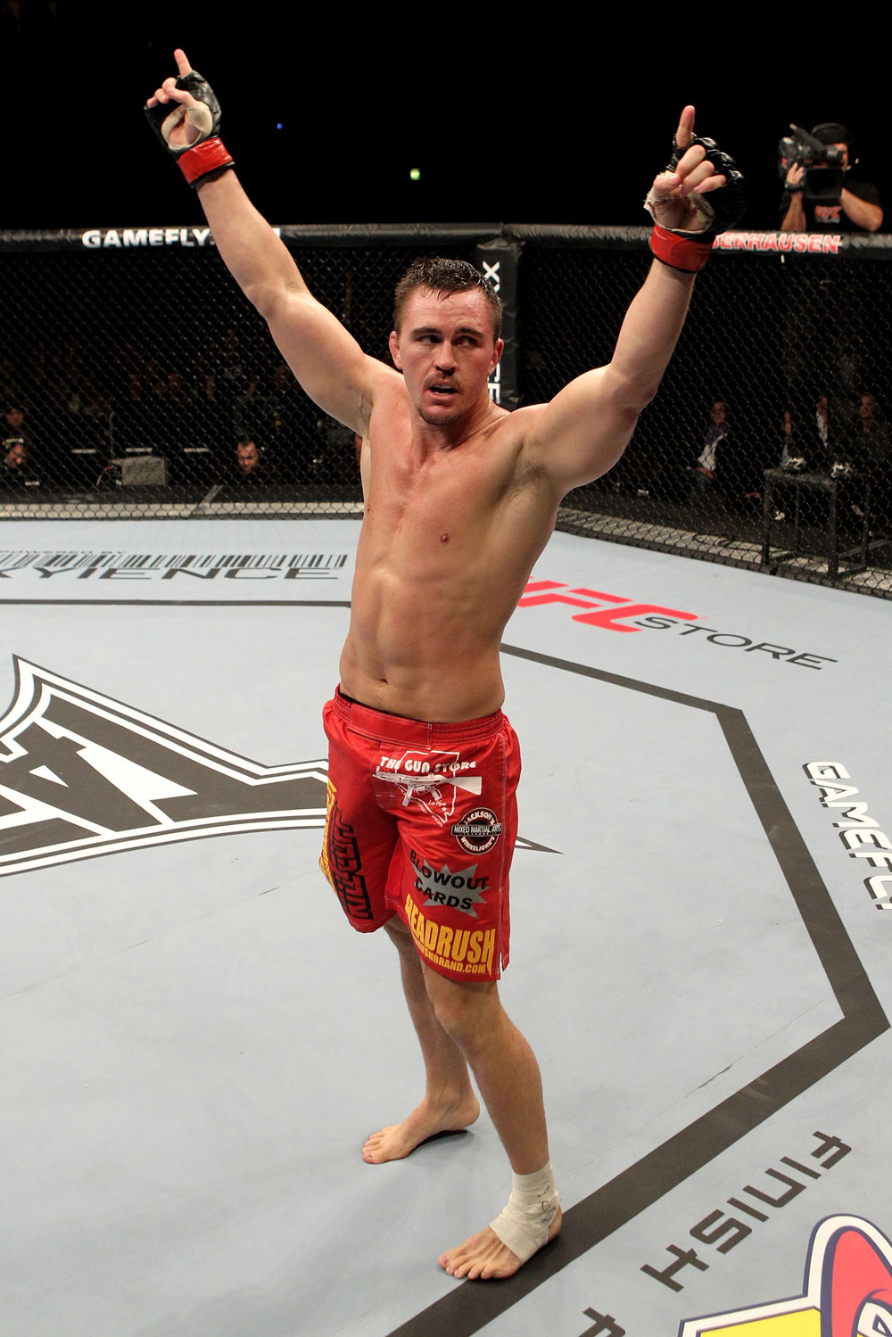 Kyle Noke of Australia celebrates victory by tap out in the 2nd round against Rob Kimmons of the USA during their UFC Middleweight bout at the Konig Pilsner Arena on November 13, 2010 in Oberhausen, Germany. (Photo by Josh Hedges/Zuffa LLC/Zuffa LLC)
