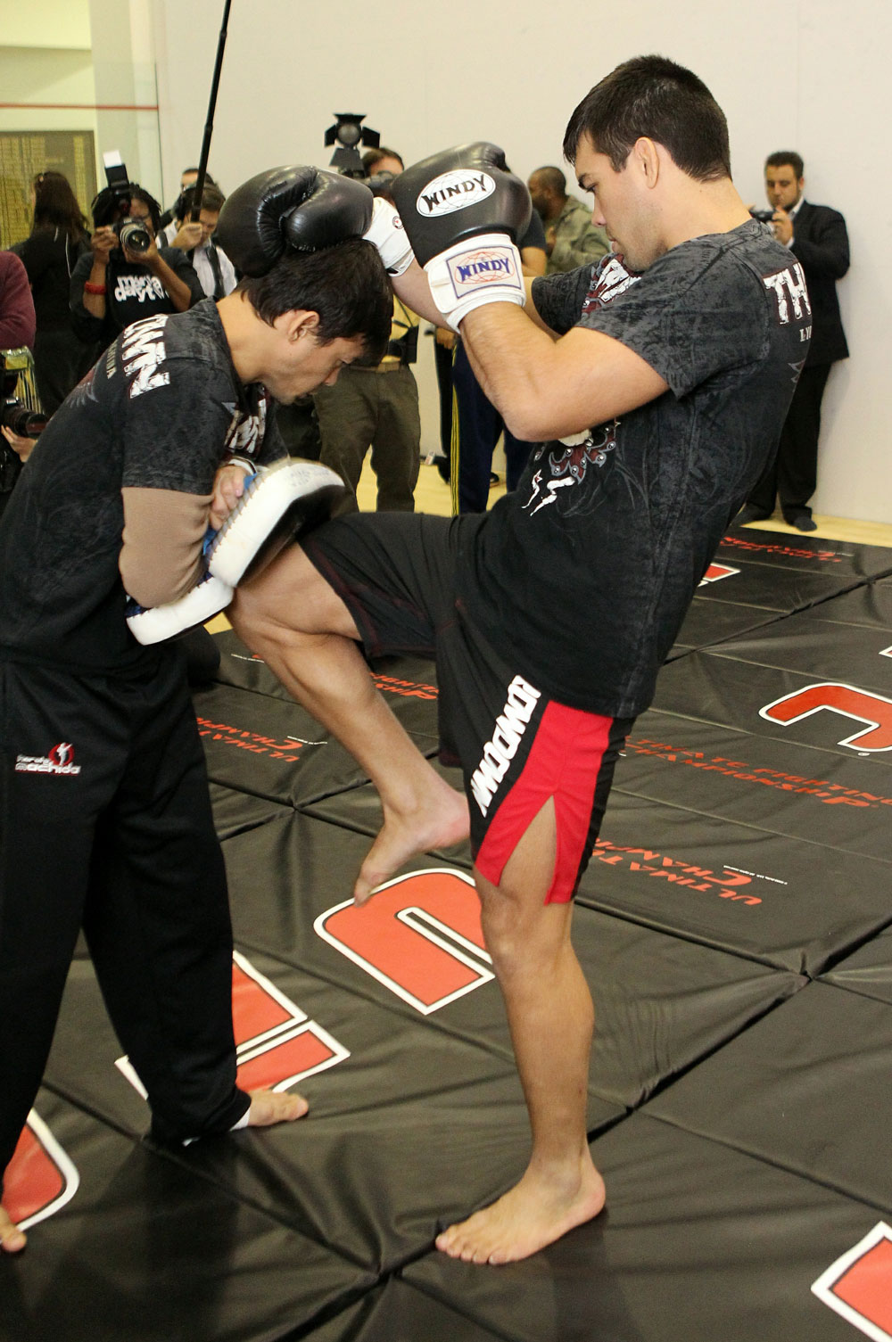 Lyoto Machida (R) works out for the media at the UFC 123 open workouts at the Detroit Athletic Club in Detroit, Michigan on November 18, 2010  (Photo by Josh Hedges/Zuffa LLC/Zuffa LLC via Getty Images)