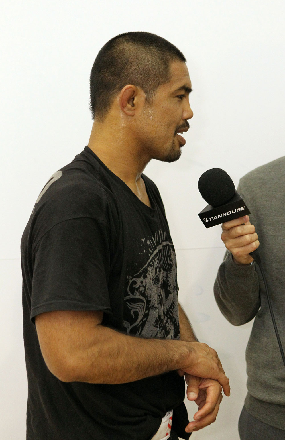 Mark Munoz answers questions from the media at the UFC 123 open workouts at the Detroit Athletic Club in Detroit, Michigan on November 18, 2010  (Photo by Josh Hedges/Zuffa LLC/Zuffa LLC via Getty Images)