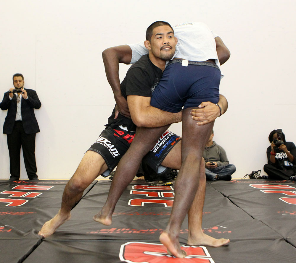 Mark Munoz (L) and Phil Davis (R) work out for the media at the UFC 123 open workouts at the Detroit Athletic Club in Detroit, Michigan on November 18, 2010  (Photo by Josh Hedges/Zuffa LLC/Zuffa LLC via Getty Images)