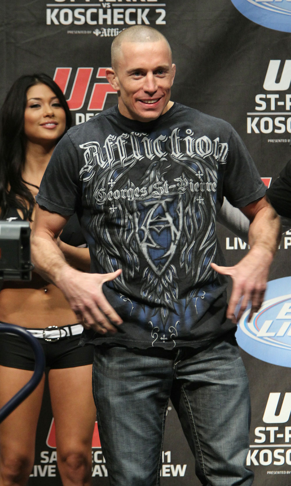 UFC 124 Weigh-in: Georges St-Pierre plays up to the crowd before his weigh in.