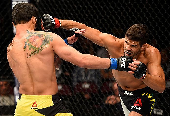 MANCHESTER, ENGLAND - OCTOBER 08:  (R-L) Leonardo Santos of Brazil punches Adriano Martins of Brazil in their lightweight bout during the UFC 204 Fight Night at the Manchester Evening News Arena on October 8, 2016 in Manchester, England. (Photo by Josh Hedges/Zuffa LLC/Zuffa LLC via Getty Images)