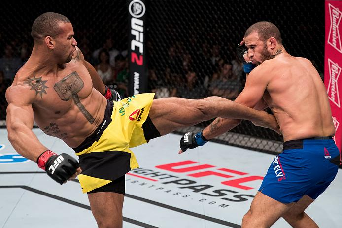 BRASILIA, BRAZIL - SEPTEMBER 24: Thiago Santos of Brazil kicks Eric Spicely of the United States in their middleweight UFC bout during tthe UFC Fight Night event at Nilson Nelson gymnasium on September 24, 2016 in Brasilia, Brazil. (Photo by Buda Mendes/Zuffa LLC/Zuffa LLC via Getty Images)
