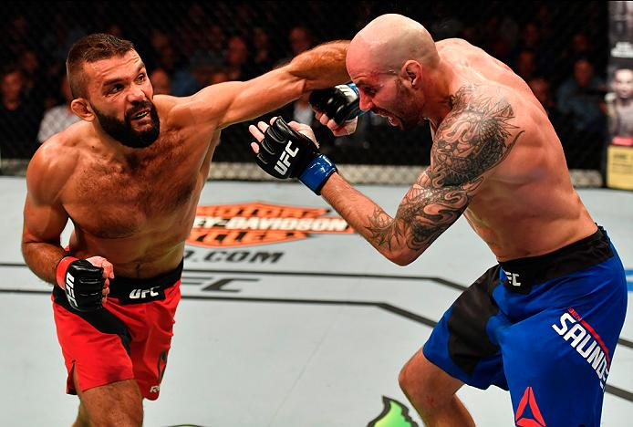 STOCKHOLM, SWEDEN - MAY 28: (L-R) Peter Sobotta punches Ben Saunders in their welterweight fight during the UFC Fight Night event at the Ericsson Globe Arena on May 28, 2017 in Stockholm, Sweden. (Photo by Jeff Bottari/Zuffa LLC/Zuffa LLC via Getty Images)