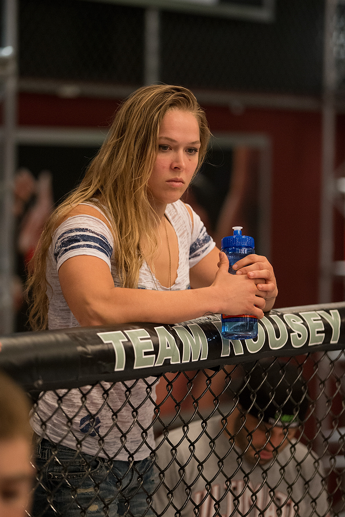 LAS VEGAS, NV - JULY 02:   Coach Ronda Rousey  stands in the corner of Michael Wooten before his semifinal fight against Chris Holdsworth during filming of season eighteen of The Ultimate Fighter on July 2, 2013 in Las Vegas, Nevada. (Photo by Josh Hedges/Zuffa LLC/Zuffa LLC via Getty Images) *** Local Caption *** Ronda Rousey