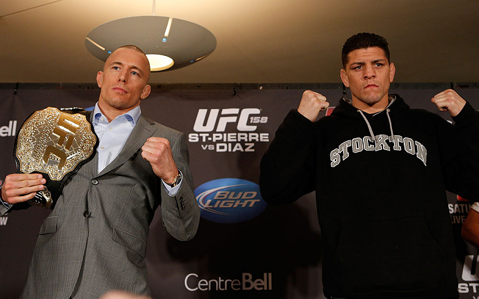 MONTREAL, QC - MARCH 14:  (L-R) Opponents Georges St-Pierre and Nick Diaz pose for photos during the final press conference ahead of his UFC 158 bout at Bell Centre on March 14, 2013 in Montreal, Quebec, Canada.  (Photo by Josh Hedges/Zuffa LLC/Zuffa LLC via Getty Images)