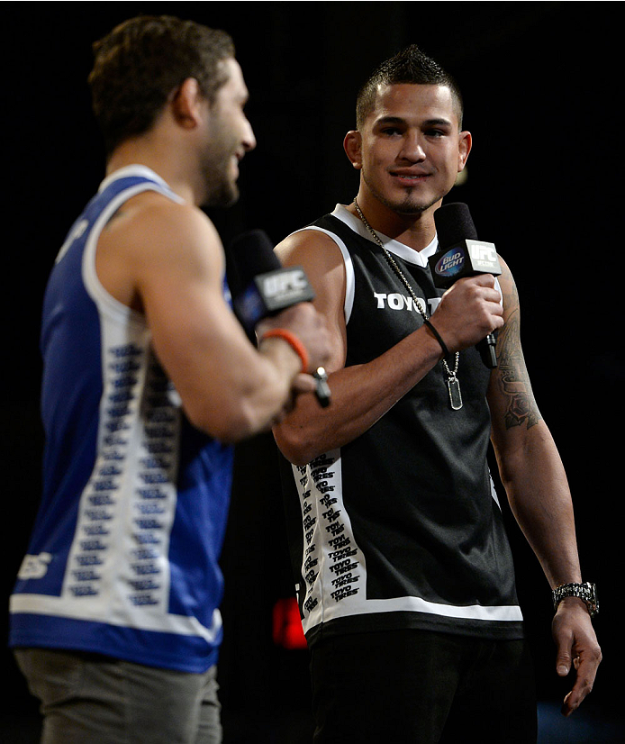 DALLAS, TX - MARCH 14:  (L-R) Chad Mendes and UFC Lightweight Champion Anthony 'Showtime' Pettis interact with fans during a Q&A session before the UFC 171 weigh-in event at Gilley's Dallas on March 14, 2014 in Dallas, Texas. (Photo by Jeff Bottari/Zuffa LLC/Zuffa LLC via Getty Images)