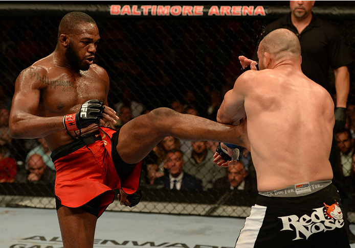 "BALTIMORE, MD - APRIL 26:  (L-R) Jon ""Bones"" Jones kicks Glover Teixeira in their light heavyweight championship bout during the UFC 172 event at the Baltimore Arena on April 26, 2014 in Baltimore, Maryland. (Photo by Patrick Smith/Zuffa LLC/Zuffa LLC via Getty Images)"