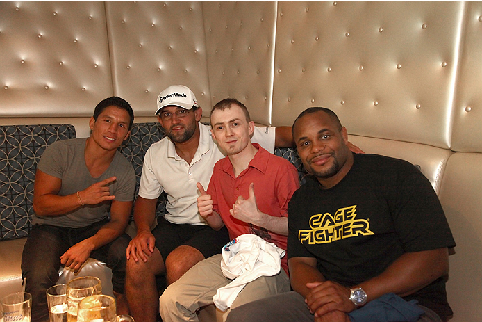 LAS VEGAS, NV - JULY 1:  (L-R) Joseph Benavidez, UFC Welterweight Champ Johnny Hendricks, and Daniel Cormier watch the 2014 FIFA World Cup Brazil Round of 16 match between USA and Belgium with fans to kick off the UFC International Fight Week at Legasse's Stadium at The Palazzo Las Vegas on July 1, 2014 in Las Vegas, Nevada. (Photo by Brandon Magnus/Zuffa LLC/Zuffa LLC via Getty Images)