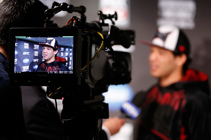 SAN JOSE, CA - APRIL 18:  Gilbert Melendez conducts interviews during media day ahead of the UFC on FOX event at HP Pavilion on April 18, 2013 in San Jose, California.  (Photo by Josh Hedges/Zuffa LLC/Zuffa LLC via Getty Images)
